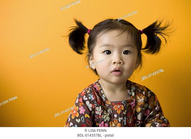 astonished looking asian baby