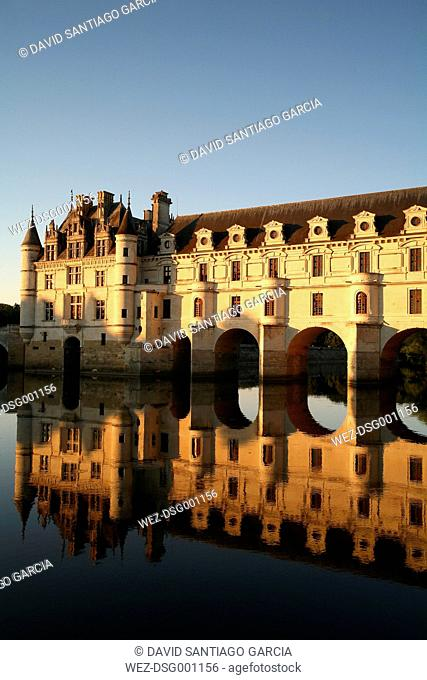 France, Chenonceaux, view to Chateau de Chenonceau with water reflection