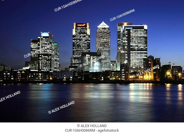 A night time, long exposure image of the skyscrapers around Canary Wharf, in Docklands, and the River Thames