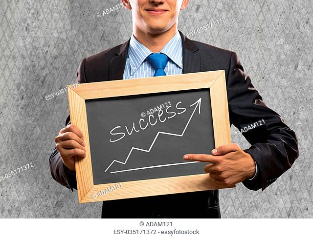 Close up of businessman holding chalkboard with word success