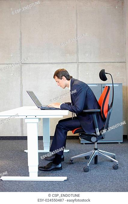 Bad sitting posture at laptop