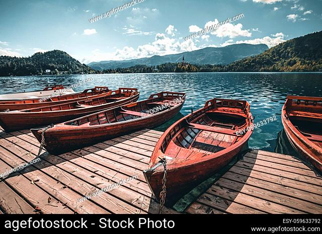 Traditional Pletna boat on the lake. In the background is the famous old church