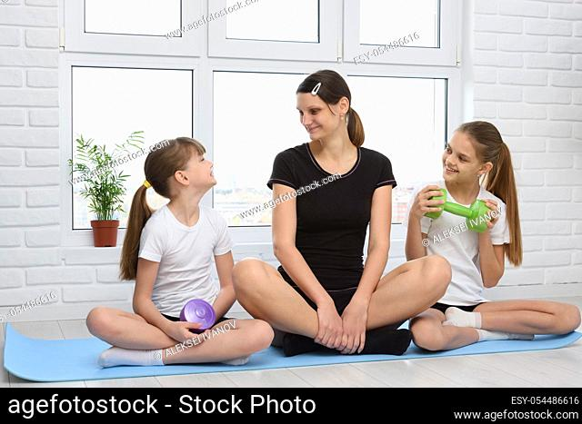 Girls' fitness classes with their mom at home