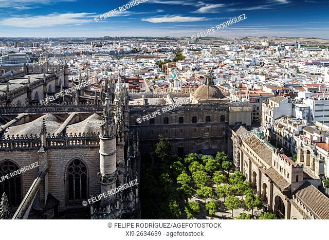 Westward view of Seville city center from the Giralda tower, Spain. On the foreground, the Court of Oranges and the Cathedral