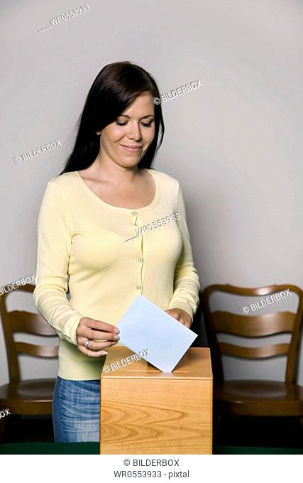 A young woman at elections in the voting booth.Voting in a democracy