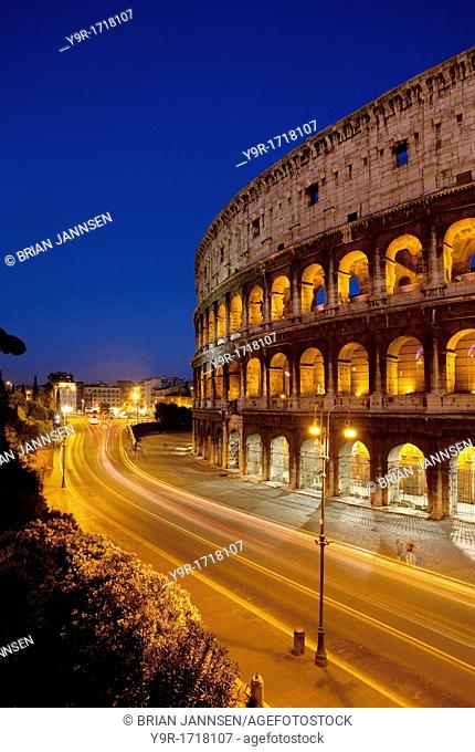Car light-trails in front of the Roman Coliseum at dusk, Rome Lazio Italy