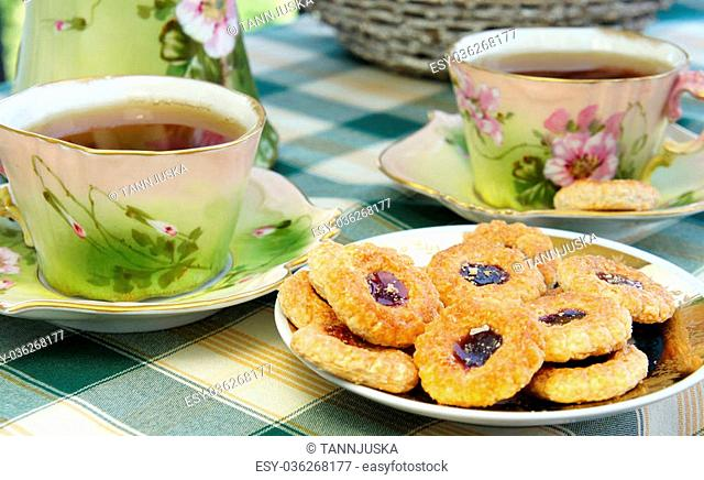 Tea time - beautiful old antique service in secession style with tasty biscuits
