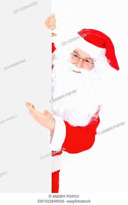 Portrait of a santa holding blank placard