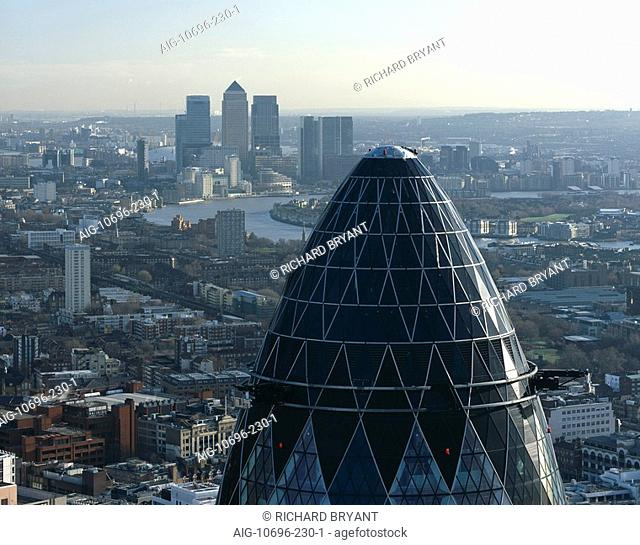 City of London with top of 30 St Mary Axe, City of London The Gherkin, Swiss Re Tower, 1997 - 2004. Canary Wharf on the horizon