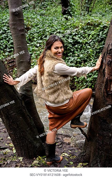 Woman standing in middle of tree