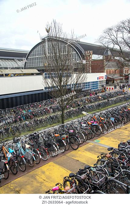 Rows of parked bicycles at central station in Amsterdam Holland