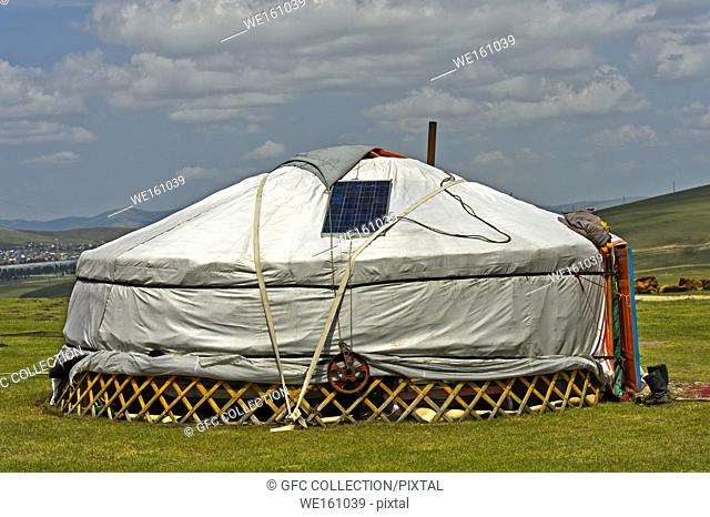 Yurts with solar panel and satellite dish in der steppe near Erdenet, Mongolia