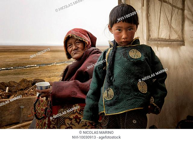 Tibetan families stick together. While parents work in the fields herding yaks, grandparents are in charge of looking after their grandchildren