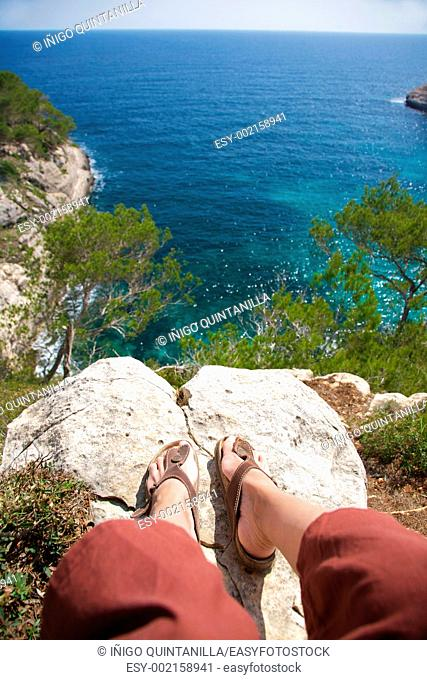 Woman on top at Menorca island in Spain