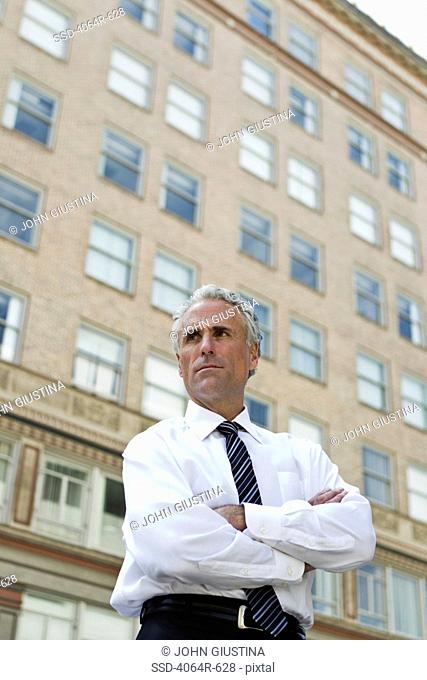 Window Arms Crossed Looking Away Stock Photos And Images