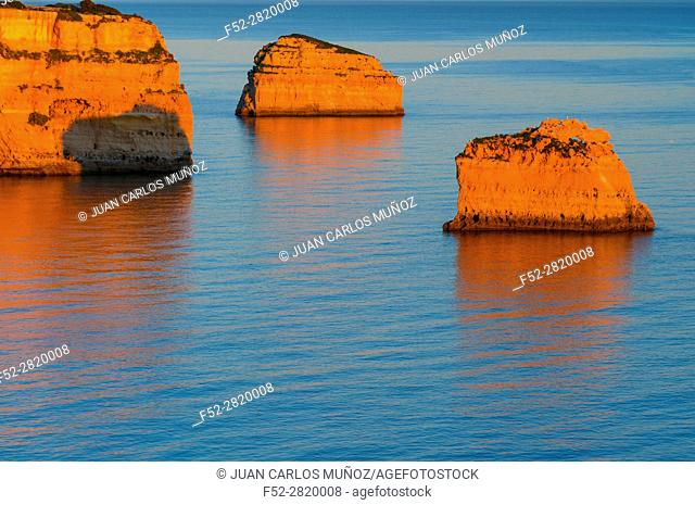 Cliffs along Praia da Marinha at Atlantic Ocean at sunset, Algarve, Portugal