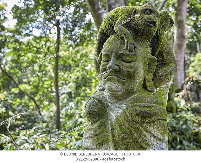 Mossy stone statue in the Sacred Monkey Forest Sanctuary. Ubud, Bali, Indonesia