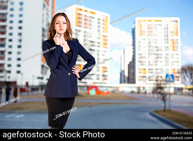 Businesswoman stands on the street in the city