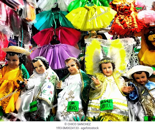 Sculptures of Baby Jesus decorate a market in Oaxaca, Mexico