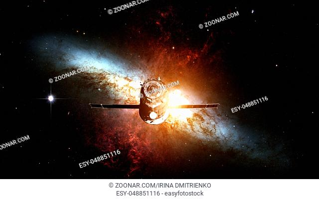 Spacecraft Progress orbiting the space nebula. Elements of this image furnished by NASA