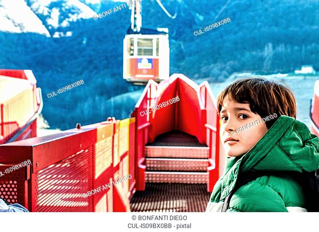 Boy at cable car station, Piani Resinelli, Lombardy, Italy