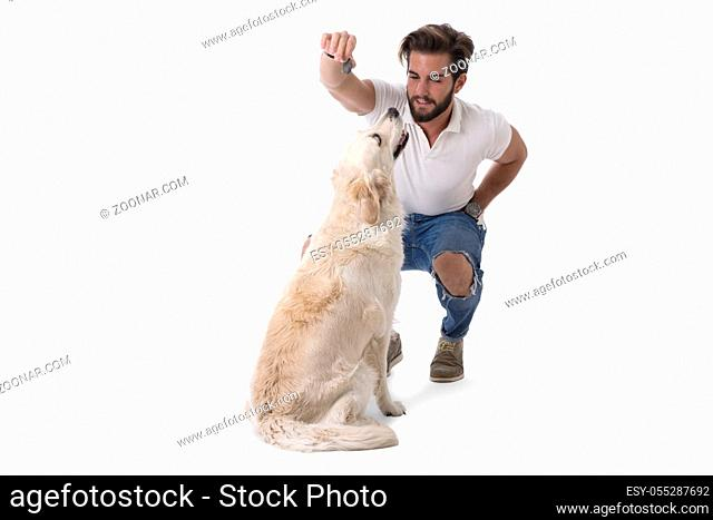 Handsome young man with labrador white dog, on white background in studio