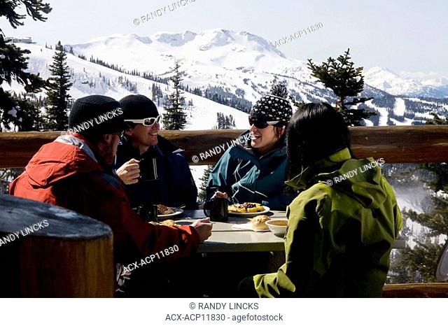 a group of skiers relaxing between runs, Whistler, British Columbia, Canada