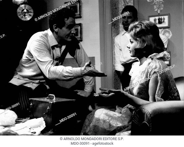 Vittorio Gassman and Sylva Koscina in La cambiale. The Italian actor and director Vittorio Gassman talking with the Italian actress Sylva Koscina before...