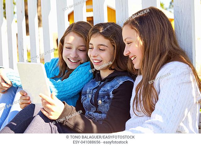 Sister girls friends having fun with technology mobile and tablet