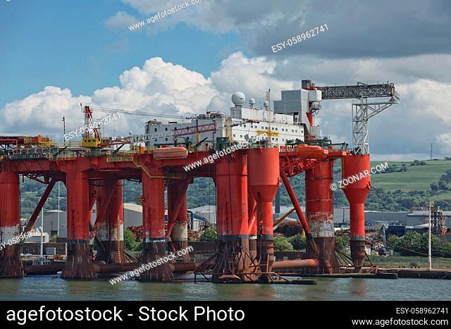 Belfast, Ireland - June 9, 2017: Large industrial cranes loading container ship in Belfast Port in Ireland