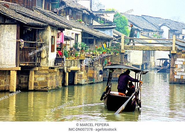 China, Zhejiang, Wushen, boat on the canal