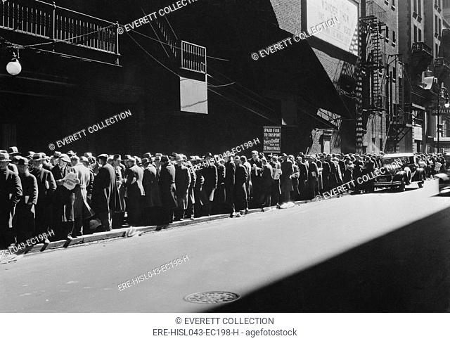 New York men in a bread line during the Great Depression, 1935-38. The sign read, 'Paid Up to this Point, Every Dollar pays for 20 More Meals