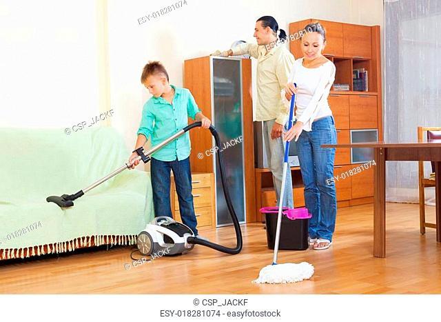 family of three doing housework