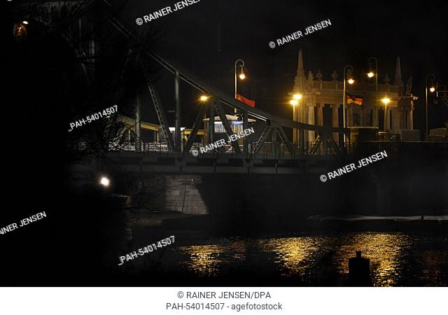 The Glienicke Bridge between Berlin and Potsdam lit up for a film shoot in Berlin, Germany, 28 November 2014. The historical Glienicke Bridge is closed until...
