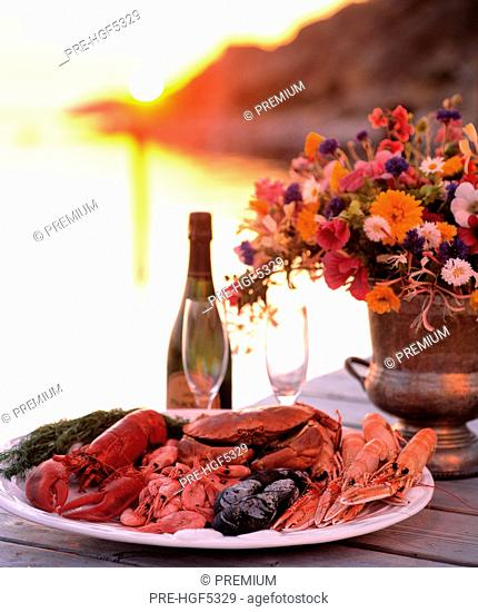 Shellfish - Shellfish and wine on a  - table by the beach