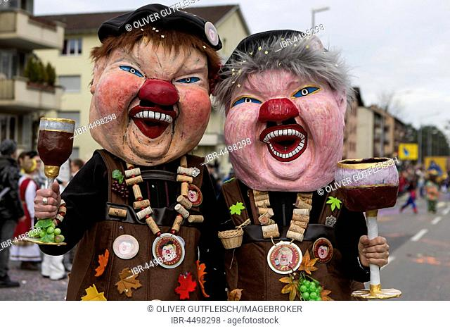 Costumed winegrowerswith glas of wine, carnival procession, Littau, Lucerne, Switzerland