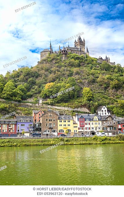 The beautiful Reichsburg Cochem (Cochem Imperial Castle 11th century) with village and the river Moselle in the foreground, Cochem, Rhineland-Palatinate