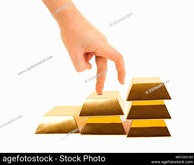 Hand and stairs made of gold bars isolated on white background
