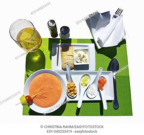 Gazpacho soup and ingredients with beer display isolated on white