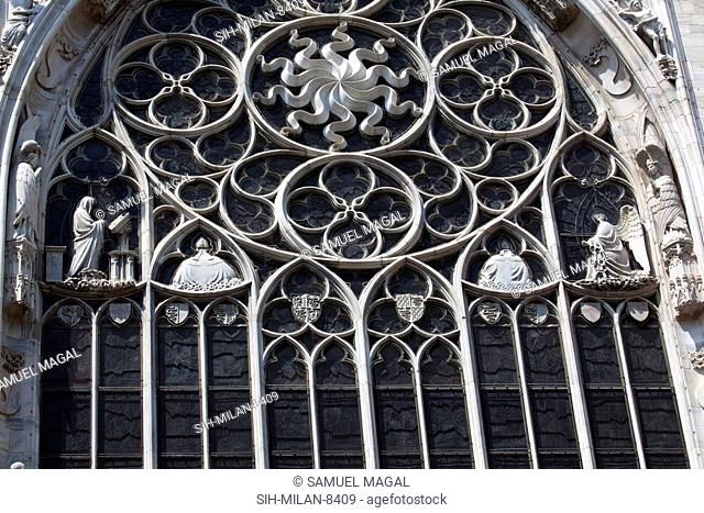 Three large windows, one of which are seen in the picture, is divided by narrow ribs into twelve slender lancets culminating above in the tracery of the rose...