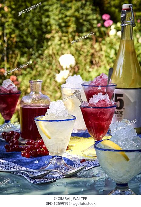 Redcurrant and lemon syrup on crushed ice