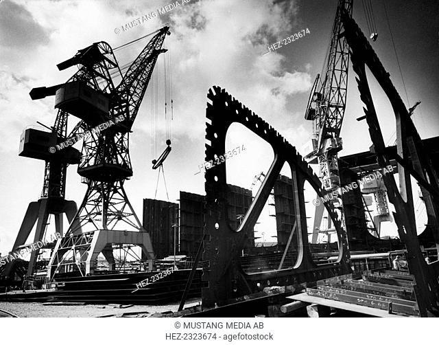 Cranes, Kockums shipyard, Malmö, Sweden, 1956. From the Malmo Stadsarkiv Collection