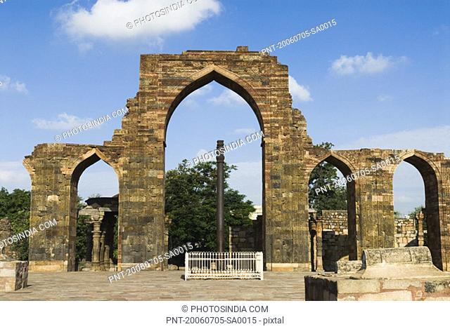 Iron pillar in the courtyard of a monument, Qutab Minar, New Delhi, India