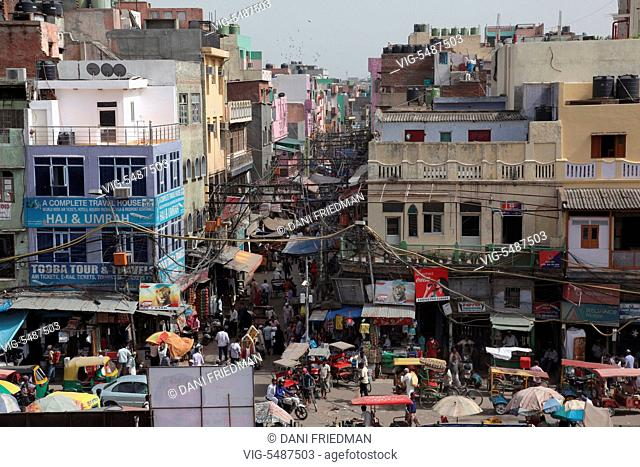 Crowded street by the Urdu Market in the Muslim Quarter in the city of Old Delhi, India. - OLD DELHI, DELHI, INDIA, 10/07/2014