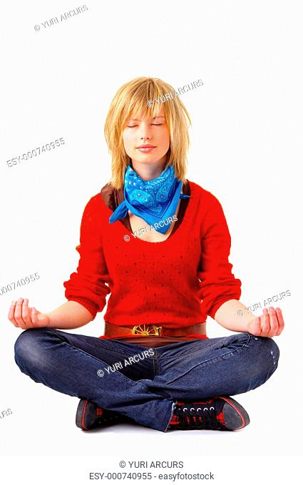 A young beautiful girl meditating in lotus position Relaxed, and focused on her inner peace Unique Keyword for this collection is: meditation123