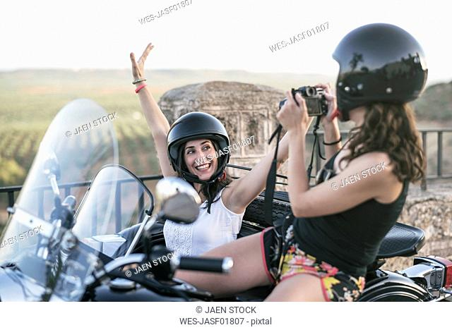 Two women with their sidecar motorcycle