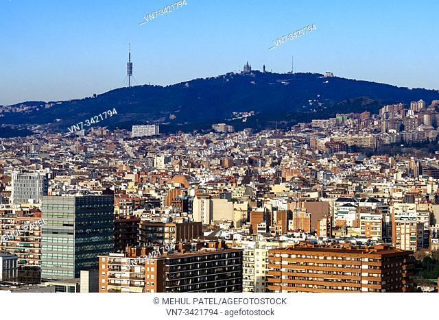 Barcelona city urbanscape looking towards hillside of Tibidabo and the Torre de Collserola, Barcelona, Catalonia, Spain