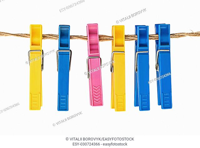 Multicolored plastic clothespins on a rope isolated on white background