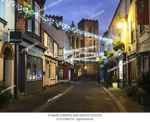 Christmas Decorations along Kirkgate with Cathedral at Dusk, Ripon, North Yorkshire, England