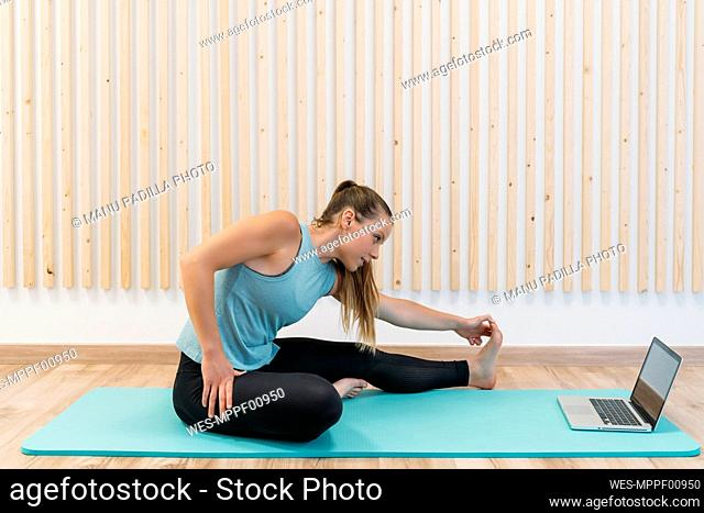 Sporty woman having an online course at health club